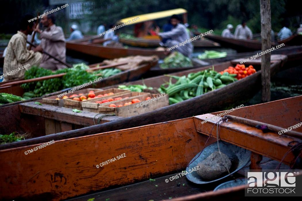 Vegetables and traders in Srinagar floating vegetable market, Stock