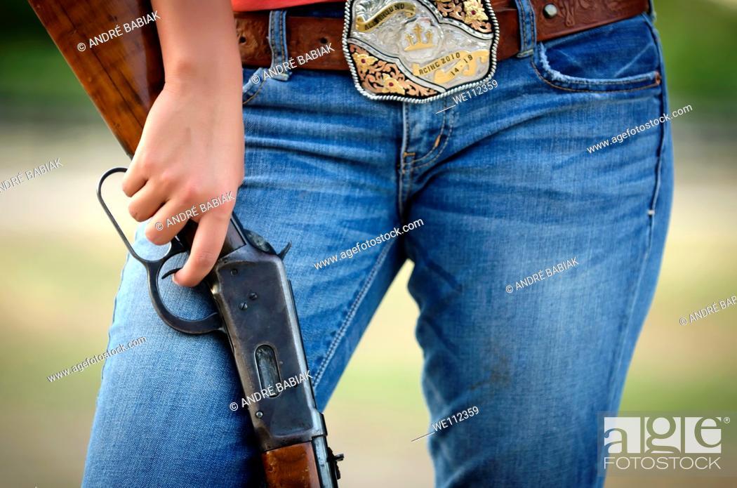 Stock Photo: Girl with rifle.