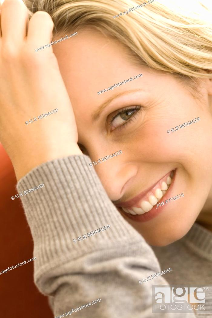Stock Photo: Portrait of a woman smiling for the camera.