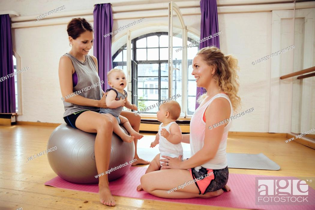 Stock Photo: Mothers and babies in exercise room.