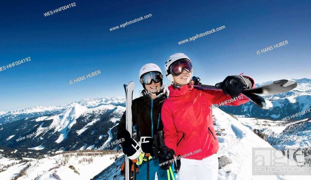 Stock Photo: Austria, Salzburg, Young couple standing on top of mountain.