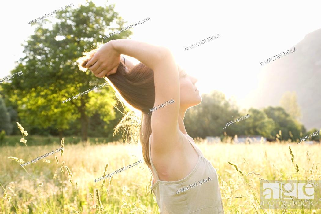 Stock Photo: Young woman in a field.