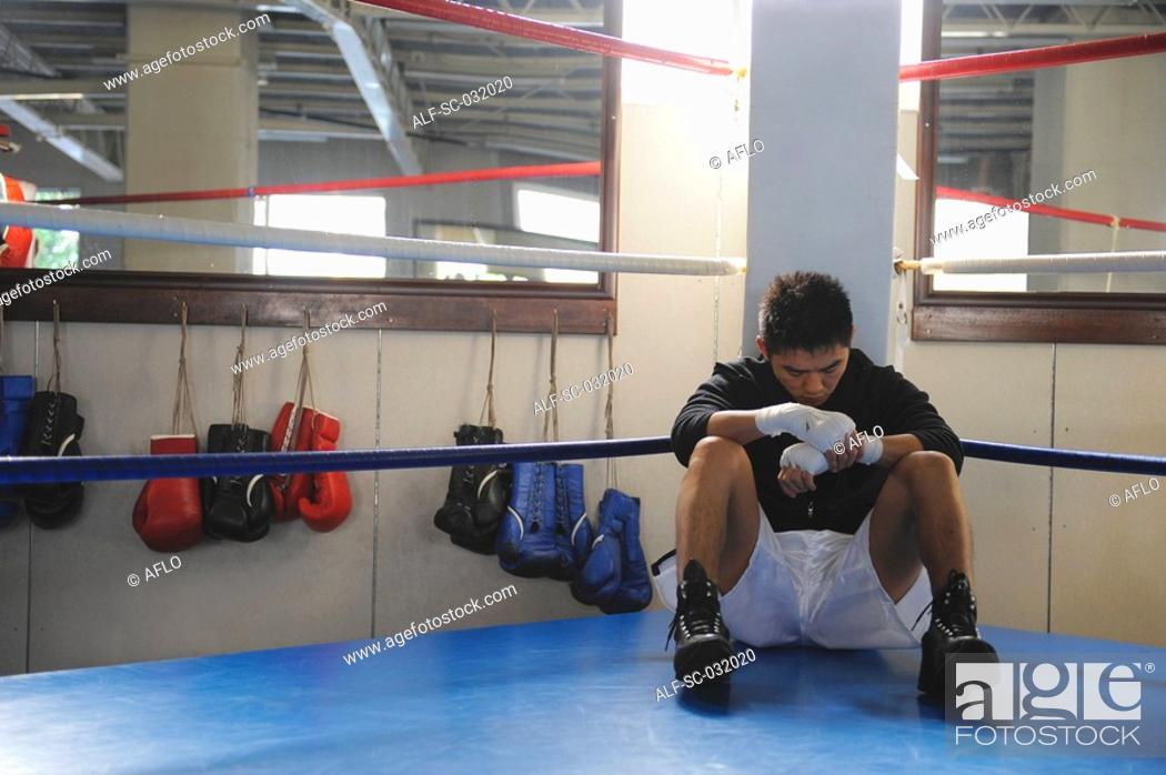 Stock Photo: Japanese boxer sitting in corner of Boxing ring.