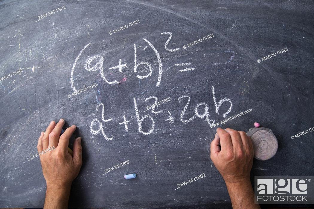 Stock Photo: Graphic representation of a mathematics formula written with chalk on the blackboard.
