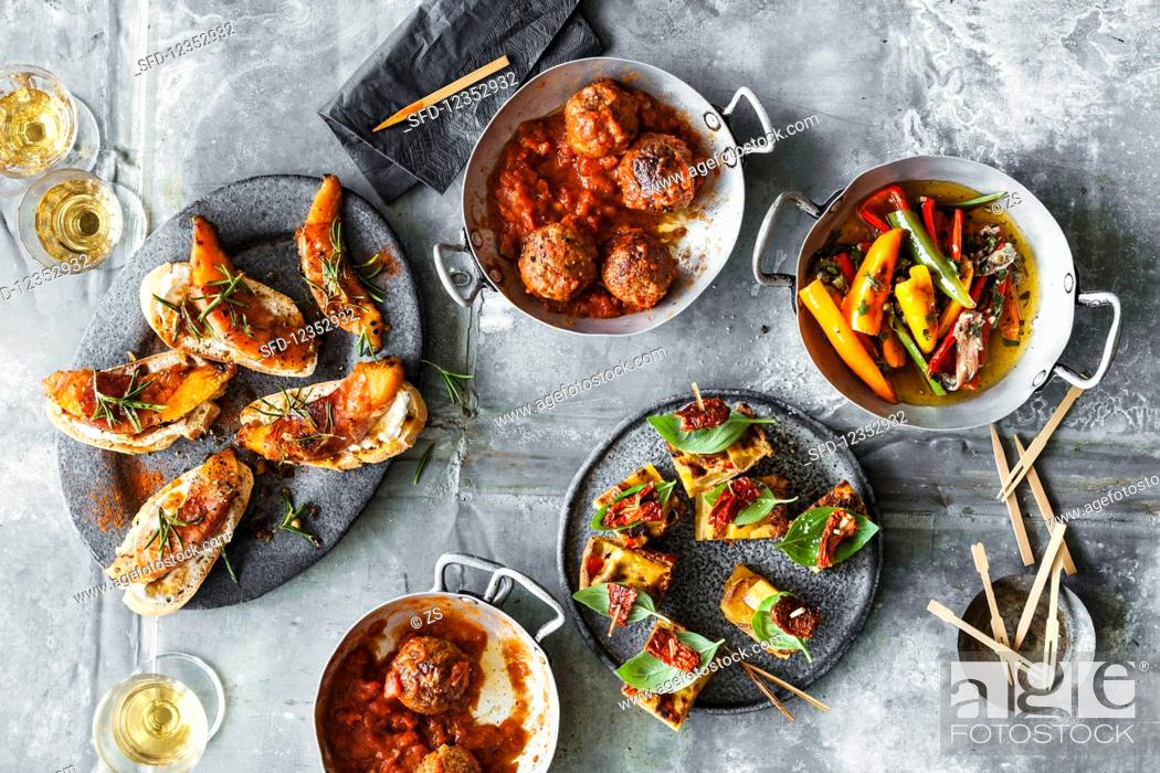 Stock Photo: Pintxos, albondigas, tortilla picante and fried peppers with anchovies.