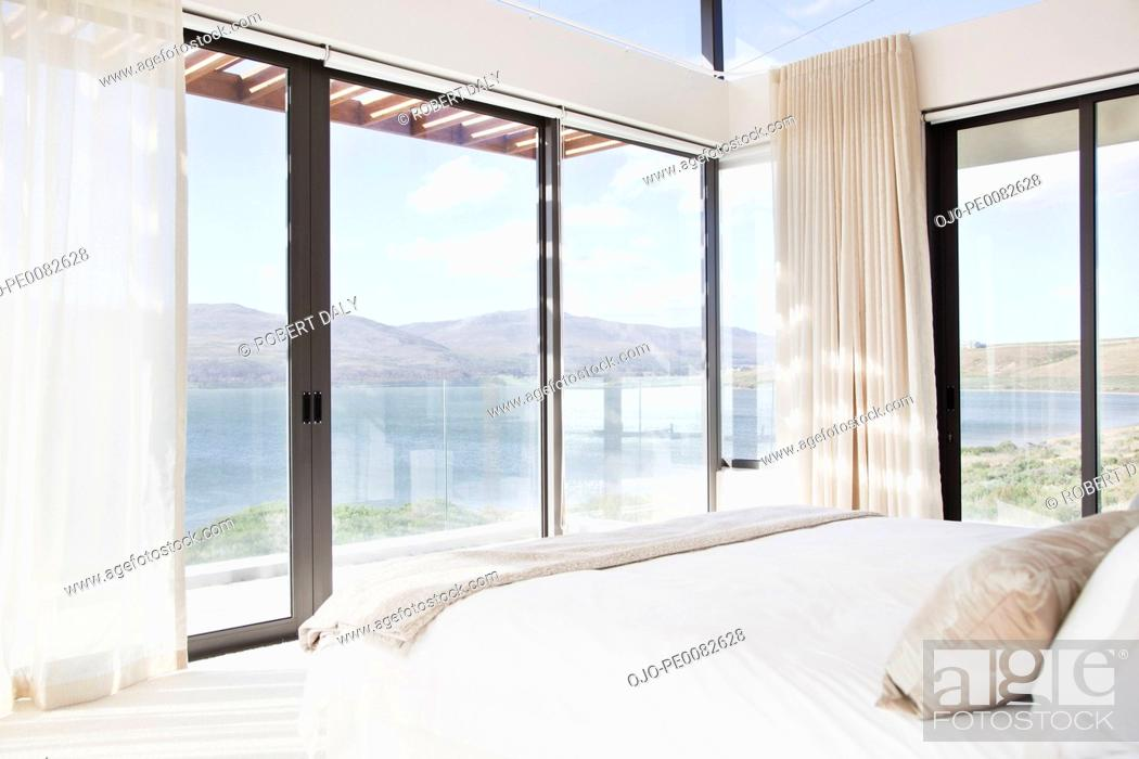 Stock Photo: Modern bedroom with view of lake.