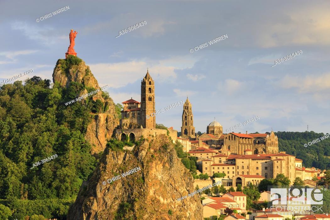 Stock Photo: Statue of Notre Dame de France with Saint Michel d'Aiguilhe Chapel and Notre Dame Cathedral Le Puy en Velay Haute-Loire Auvergne-Rhône-Alpes France.