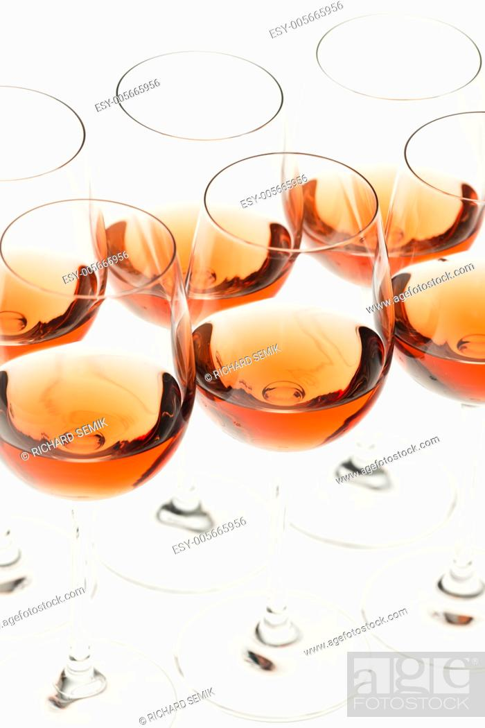 Stock Photo: wine glasses with rose wine.