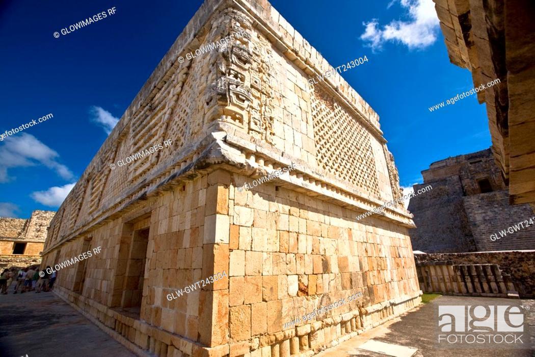 Stock Photo: Low angle view of old ruins of a building, Cuadrangulo De los Pajaros, Uxmal, Yucatan, Mexico.