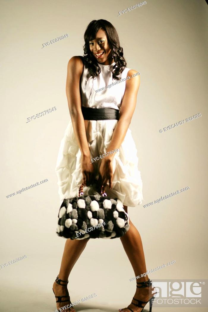 Stock Photo: Young stylish African American woman with purse.