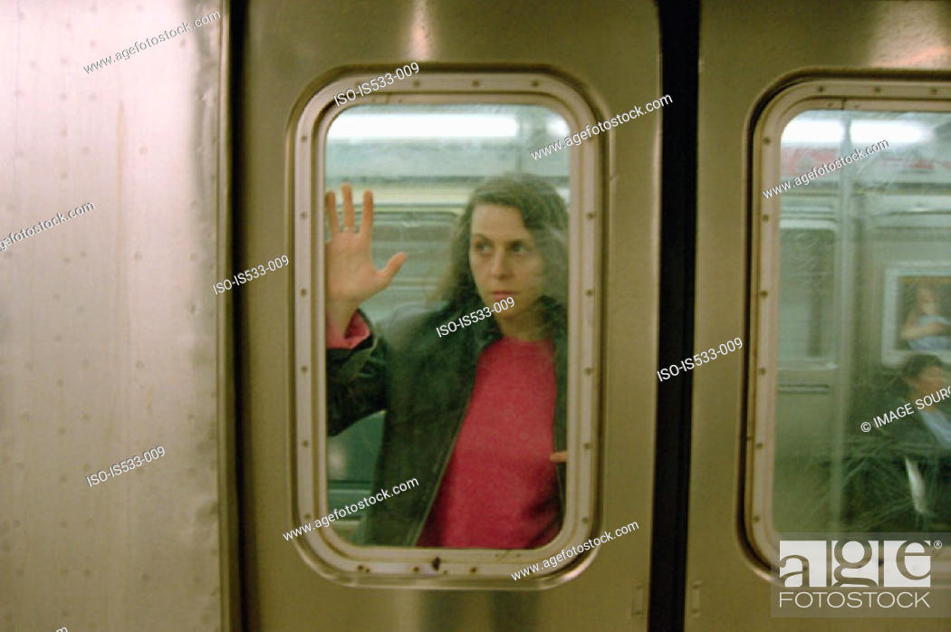 Stock Photo: Female commuter on subway train.