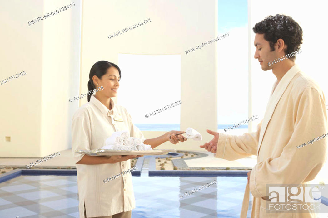 Stock Photo: Hotel employee giving out a hot towel, Los Cabos, Mexico.