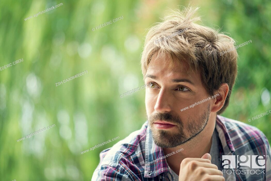 Stock Photo: Man looking away in thought, portrait.