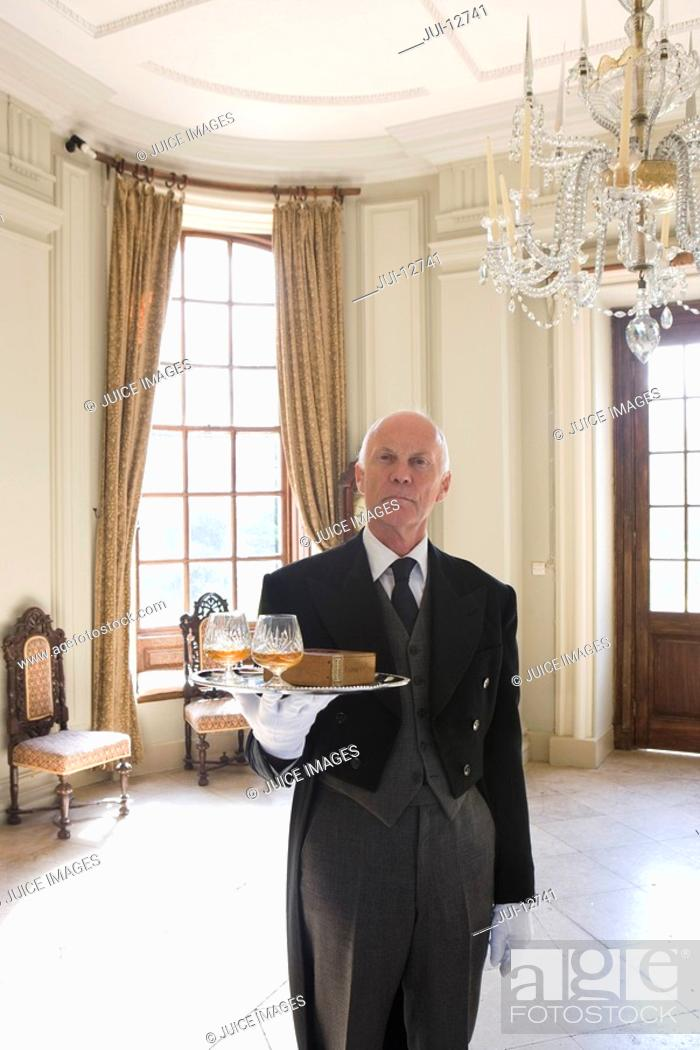 Stock Photo: Butler with tray of drinks, portrait.