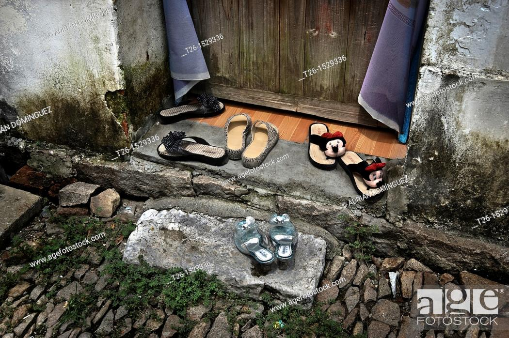 Stock Photo: Shoes in the main door of a house. Tong Li town. China country.