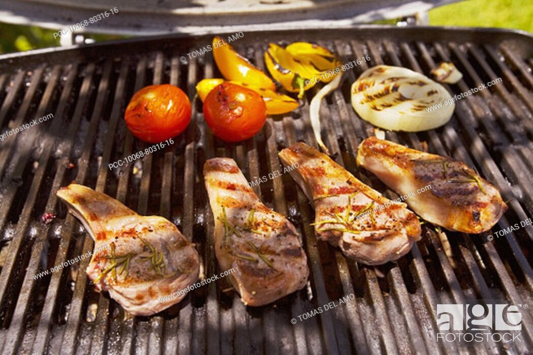 Stock Photo: Barbecue scene, Steaks on the grill.