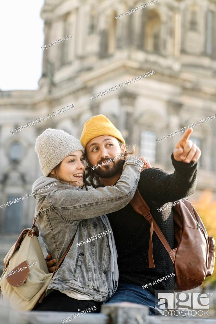 Stock Photo: Happy young couple in the city with Berlin Cathedral in background, Berlin, Germany.