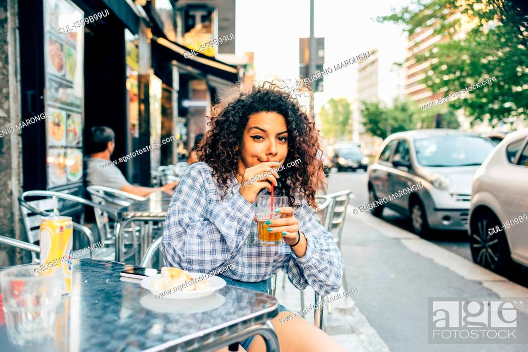 Stock Photo: Woman at pavement cafe, Milan, Italy.