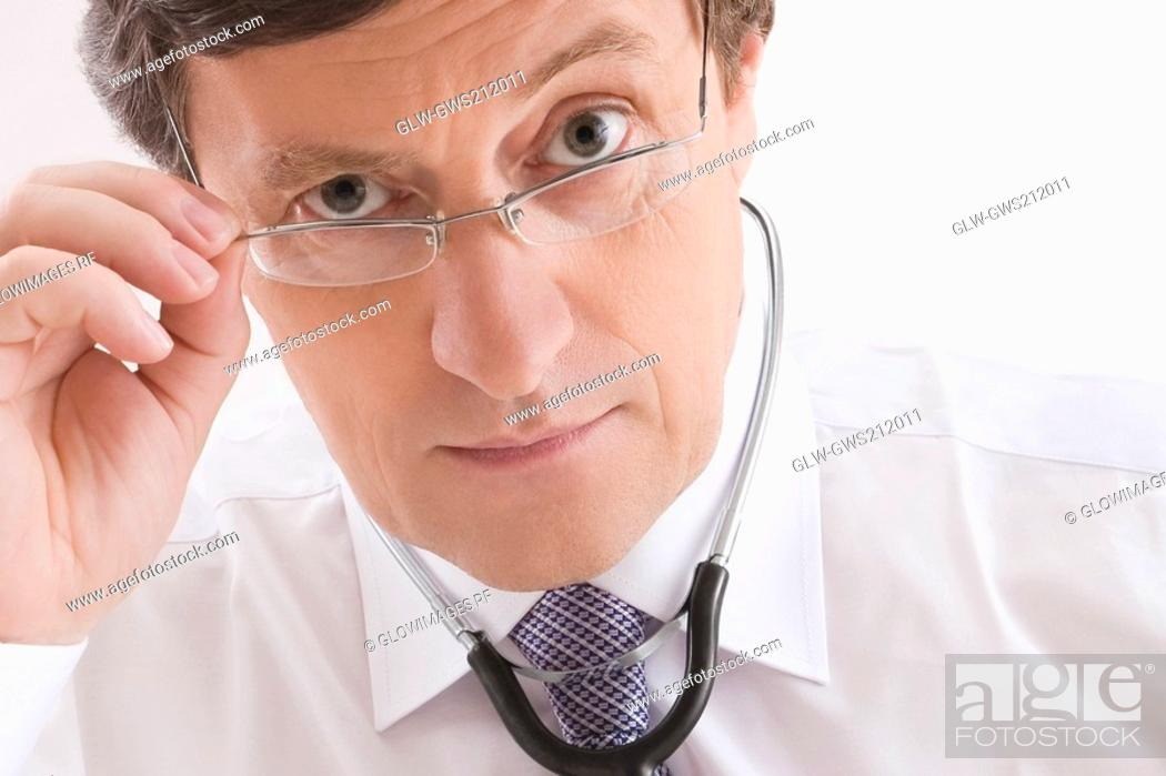 Stock Photo: Close-up of a male doctor looking worried.