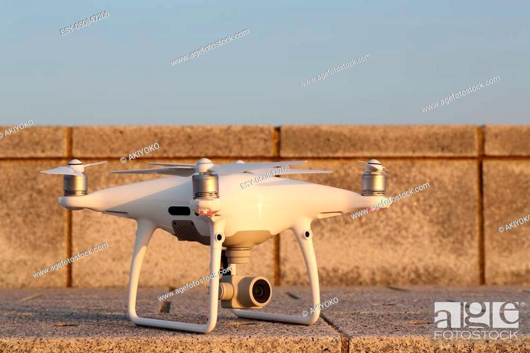Stock Photo: Drone before the flight on concrete brick.