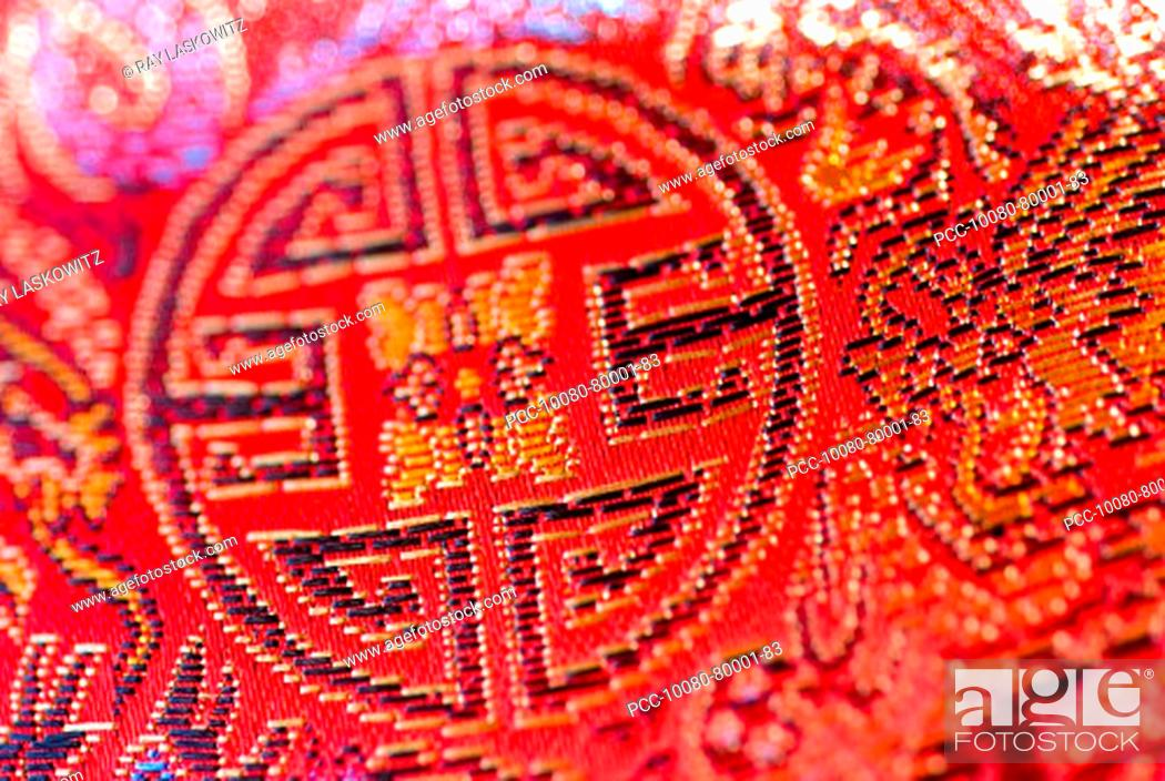Stock Photo: Close-up of bright red cloth with Chinese embroidery.