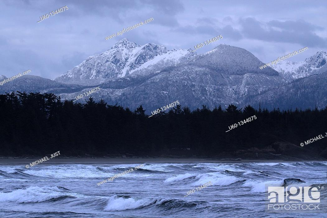 Stock Photo: High seas and snow-capped mountains make up the landscape at Tofino, British Columbia,Canada.