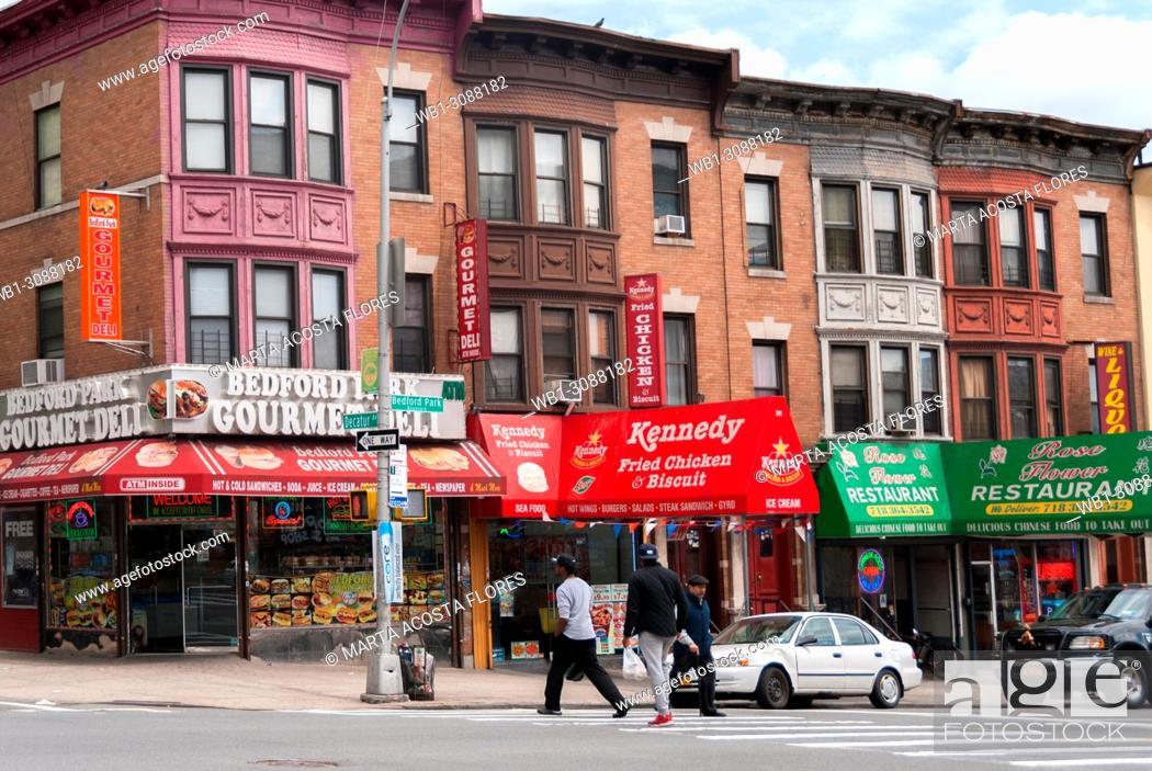 Stock Photo: Colored row house and Deli restaurants in Bedfordpark neighbourhood. Northwest Bronx, New York, U.S.A.