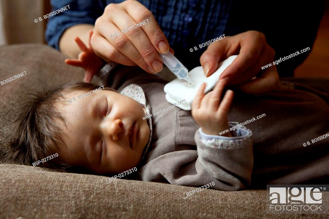 Stock Photo: NEWBORN BABY HYGIENE Models. 3-week-old baby girl.