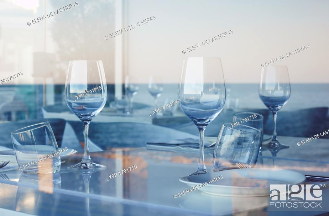 Stock Photo: Reflected sea on a restaurant's window  Denia  Alicante  Spain.