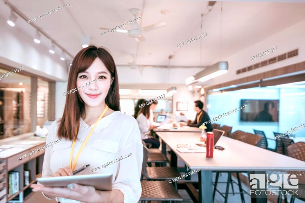 Stock Photo: young business woman working with her staff in office.