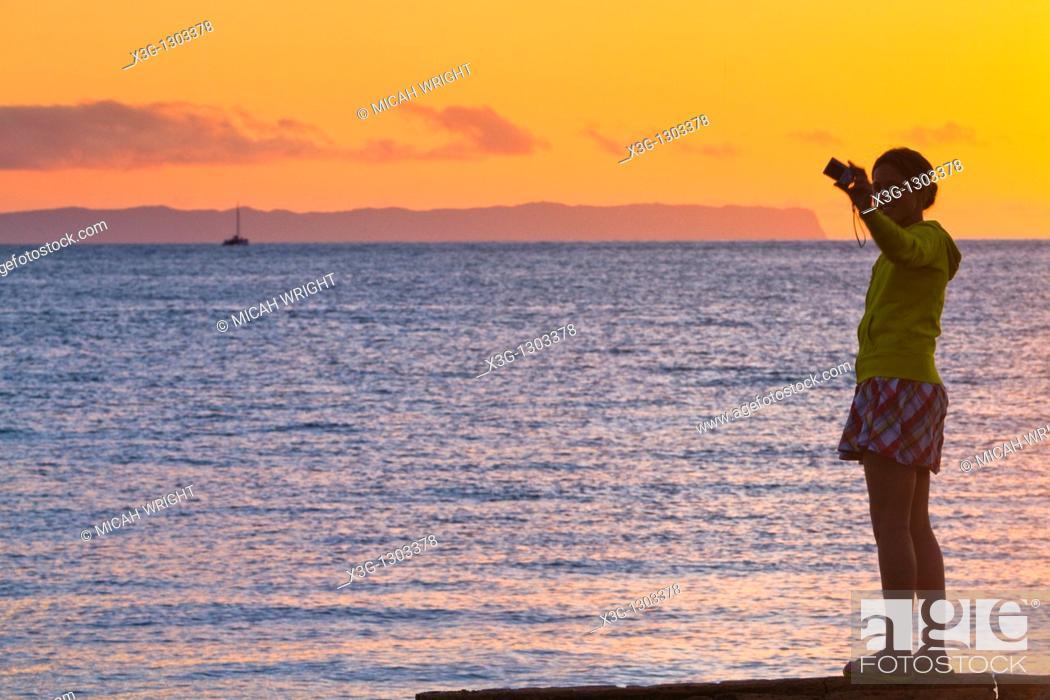 Stock Photo: A sunset reveals the island of Niihau in background, images along the open coastal region of Waimea and the western side of Kauai, Hawaii, USA.