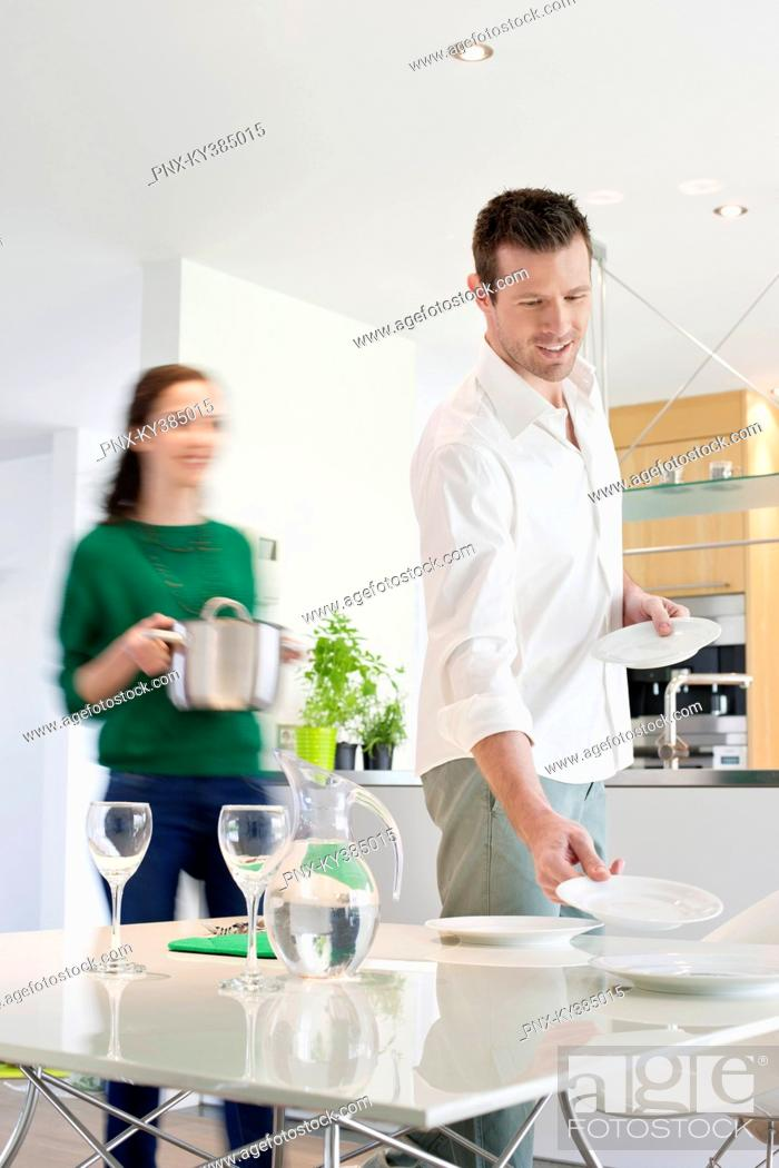 Stock Photo: Couple preparing to serve dinner.