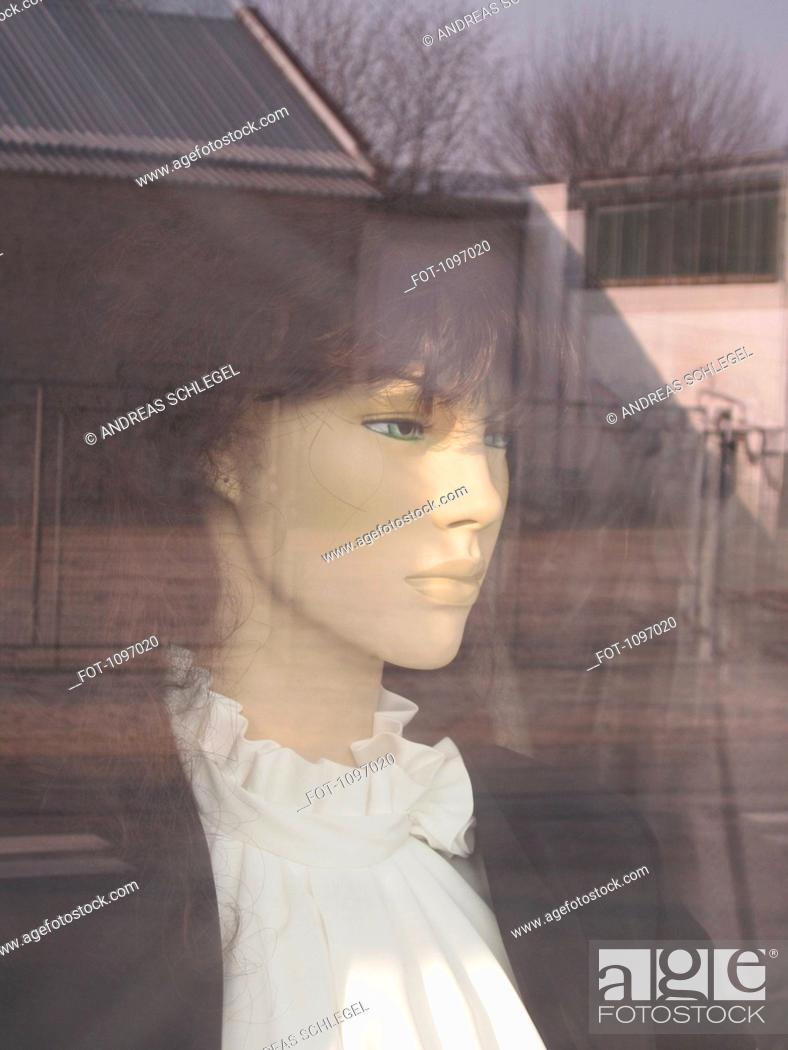 Stock Photo: Detail of a female mannequin in a store window.