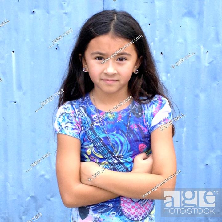 Stock Photo: Young girl looking at camera with a serious face.