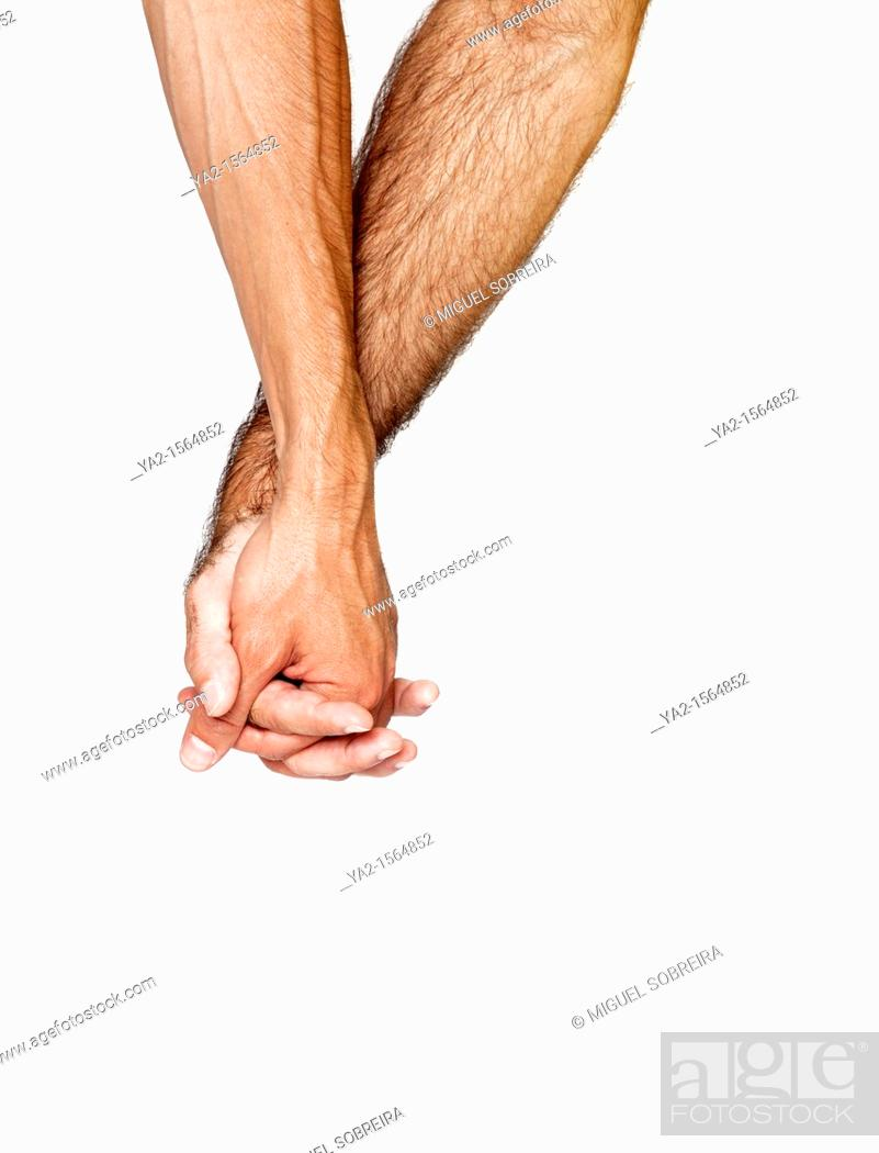 Stock Photo: Two men holding hands.