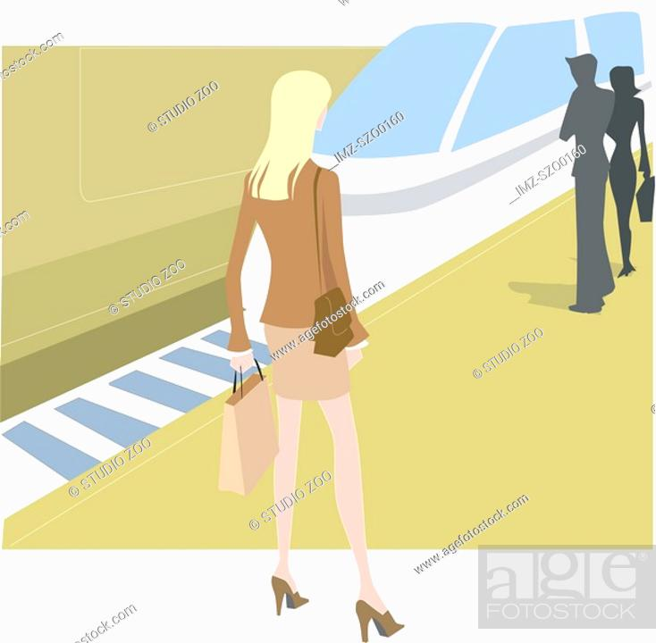 Stock Photo: A businesswoman waiting for a train.
