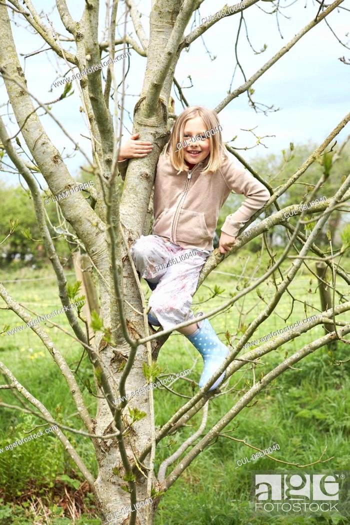 Stock Photo: Young girl in tree.
