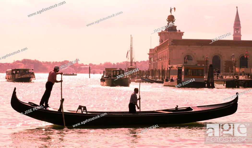Stock Photo: Gondola and gondolier, Venetian Lagoon, Venice, Veneto, Italy, Europe.