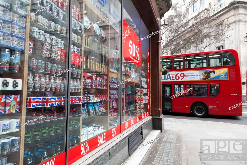 Stock Photo: Tourist souvenirs in London shop window with 50% sale poster and double decker bus.
