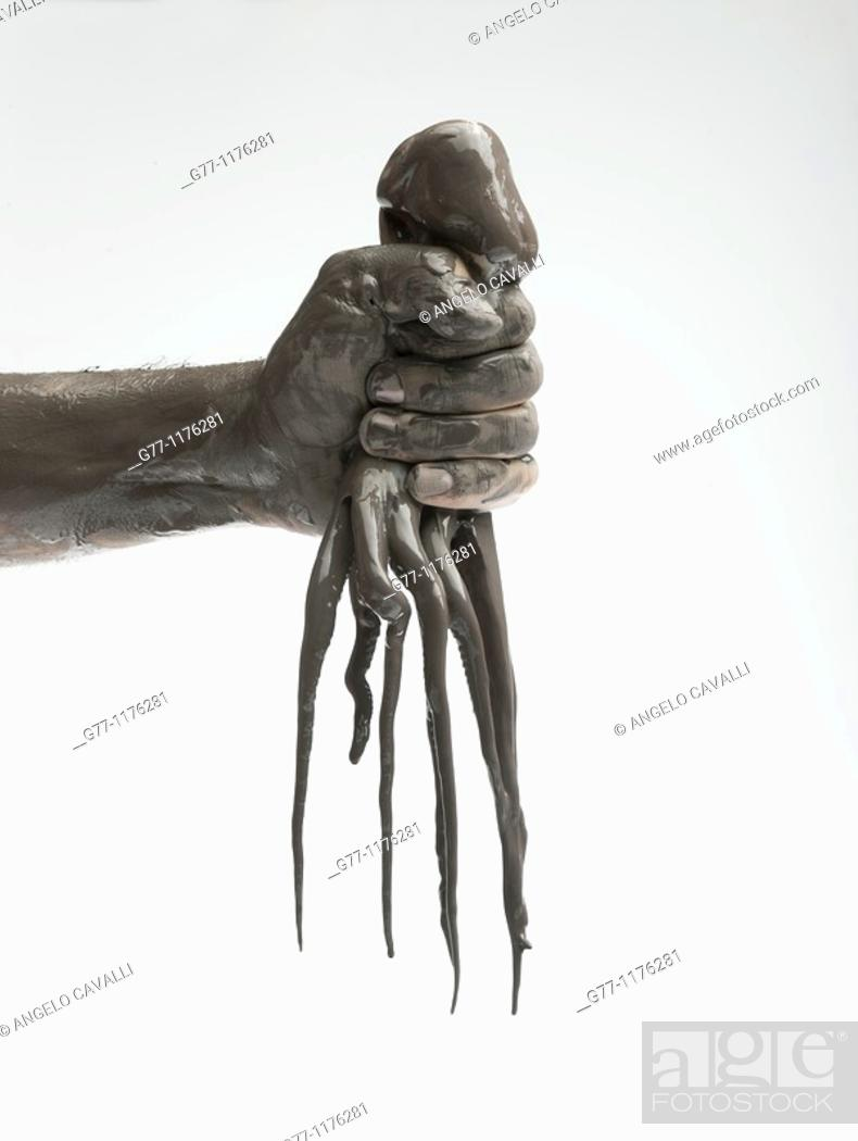 Stock Photo: Oily hand with octopus.