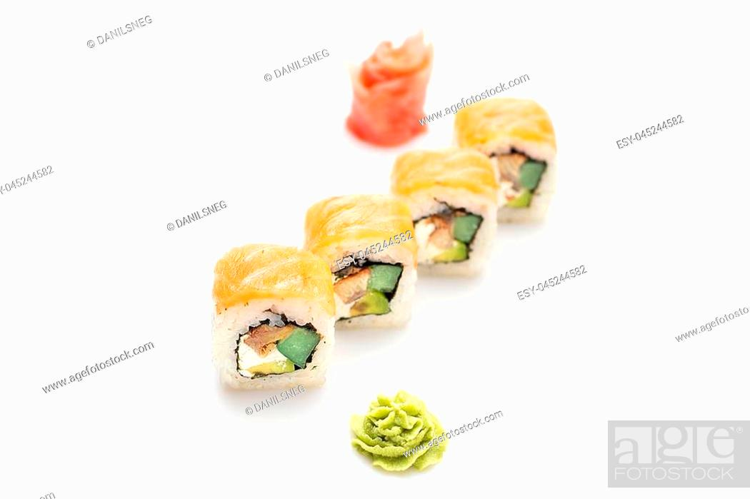 Stock Photo: Fresh and appetizing sushi rolls with an eel avocado and Philadelphia cheese wrapped in salmon. Isolated. Sushi roll on a white background.