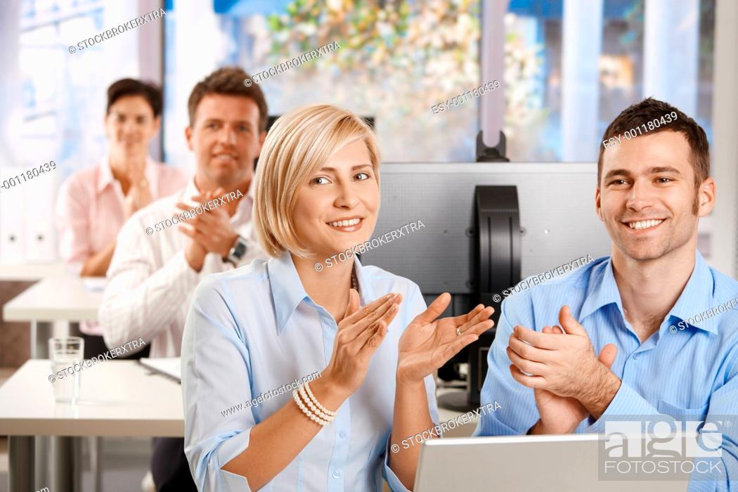 Stock Photo: Business people clapping on training.