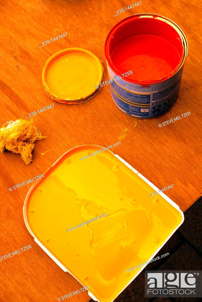 Stock Photo: Red and orange paint for decorating an interior space.