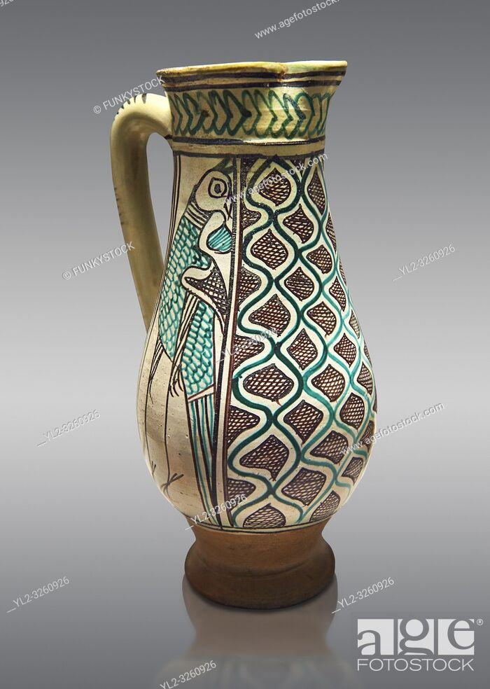 Stock Photo: Medieval ceramic jug made in Orvieto or Sienna, Italy, at the end of the 14th century. From Faience. inv 7394, The Louvre Museum, Paris.