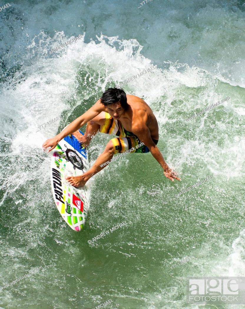 Stock Photo: Surfer catching a wave.