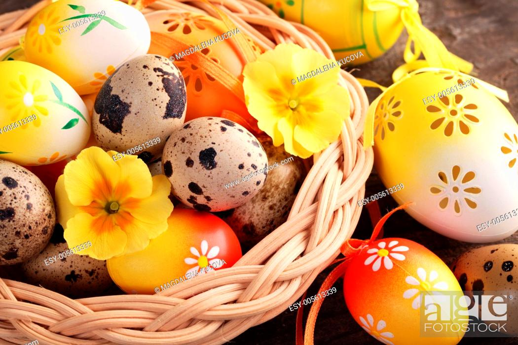 Stock Photo: Close-up of Easter and quail eggs in basket.