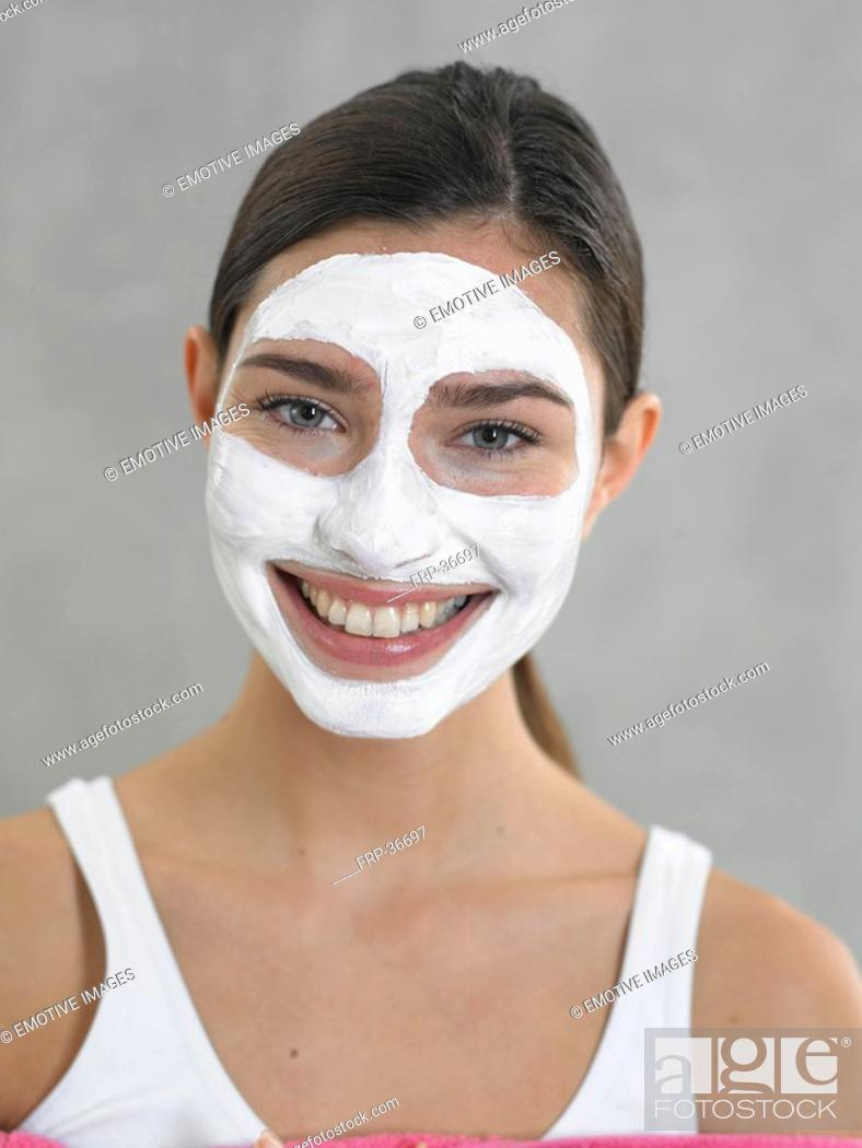 Stock Photo: Laughing woman with curd mask.