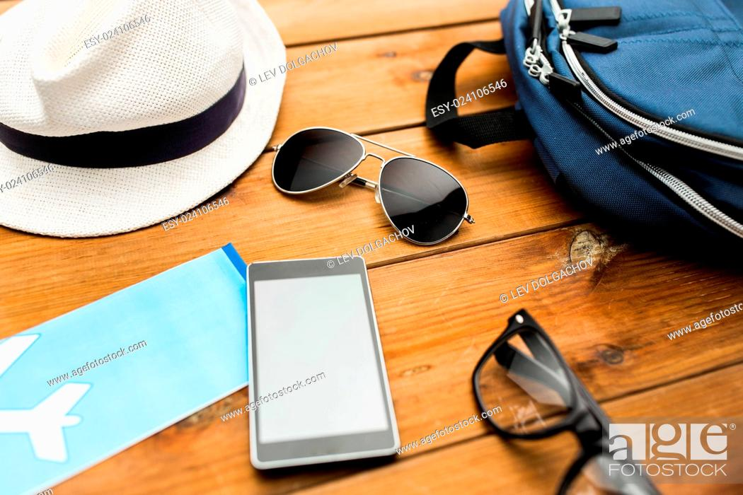 Stock Photo: vacation, travel, tourism, technology and objects concept - close up of gadgets and traveler personal stuff.