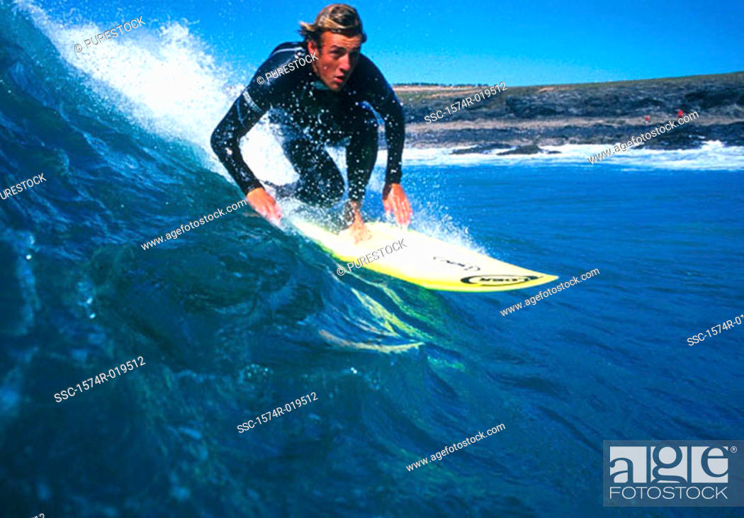 Stock Photo: Young adult man surfing, Lanzarote, Canary Islands.