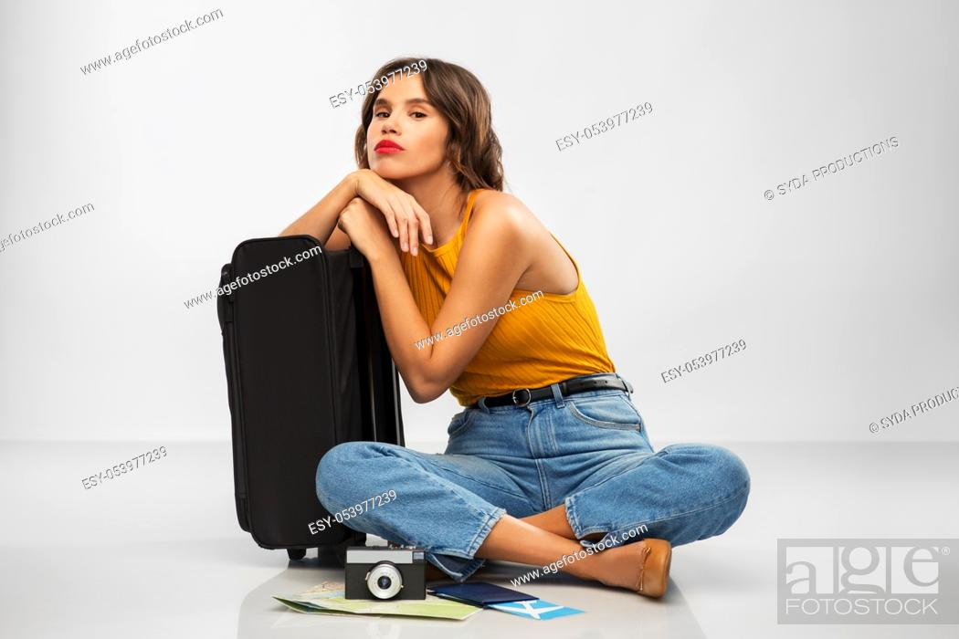 Stock Photo: woman with travel bag, air ticket, map and camera.